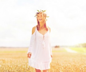 Happy woman in the wheat field Stock Photo 01