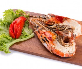 Lobster on the chopping board with vegetables and tomatoes Stock Photo