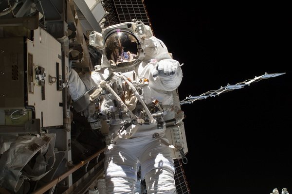 Maintenance of astronauts for space station external equipment Stock Photo