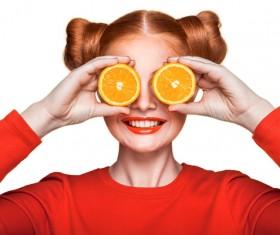 Orange cosmetics young girl holding orange 01