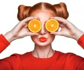 Orange cosmetics young girl holding orange 02
