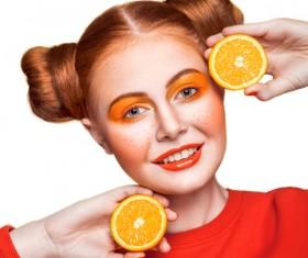 Orange cosmetics young girl holding orange 03