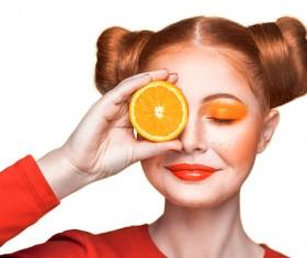 Orange cosmetics young girl holding orange 04