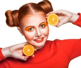 Orange cosmetics young girl holding orange 05