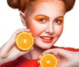 Orange cosmetics young girl holding orange 06