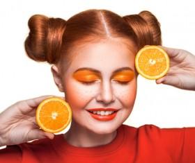 Orange cosmetics young girl holding orange 07