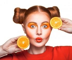Orange cosmetics young girl holding orange 08