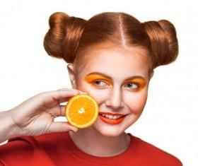 Orange cosmetics young girl holding orange 09
