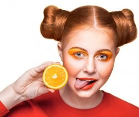 Orange cosmetics young girl holding orange 10