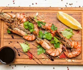 Prawns with sauce on the chopping block Stock Photo