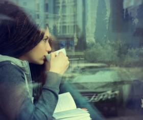 Reading girl drinking coffee Stock Photo