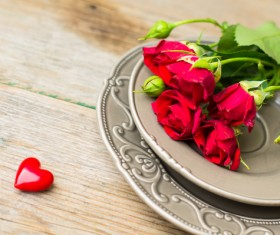 Red rose in the plate Stock Photo