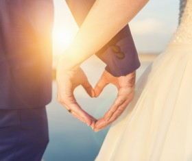 Romantic couples heart-shaped gesture Stock Photo