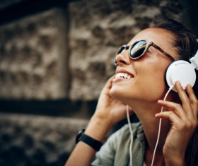 Smiling woman wearing headphones Stock Photo