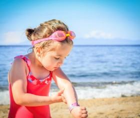 Summer little girl on the beach Stock Photo