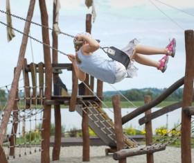 Swing the little girl Stock Photo