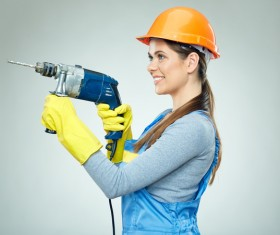 Take a female worker with an electric drill Stock Photo