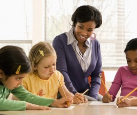 Teacher and homework of the children Stock Photo