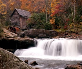 The water mill on the stream Stock Photo