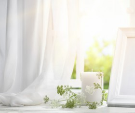 The windowsill candles and frames Stock Photo