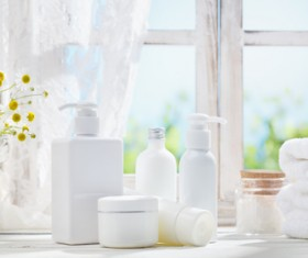 The windowsill is placed with cosmetics and towels Stock Photo