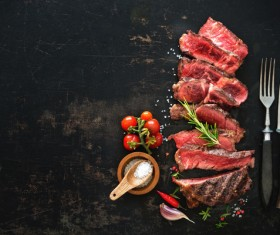 Undercooked meat and spices on the chopping block Stock Photo 02