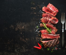 Undercooked meat and spices on the chopping block Stock Photo 03