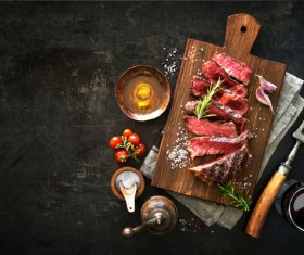Undercooked meat and spices on the chopping block Stock Photo 04
