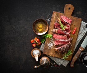 Undercooked meat and spices on the chopping block Stock Photo 05