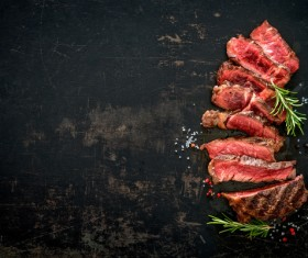 Undercooked meat and spices on the chopping block Stock Photo 07