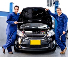 Vehicle maintenance workers Stock Photo