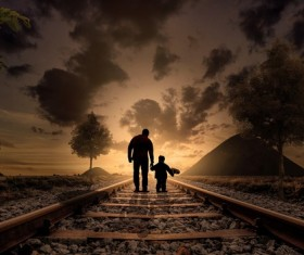 Walking on railroad father with children Stock Photo
