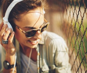 Wearing headphones listening to music young girl Stock Photo 02