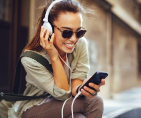 Wearing headphones listening to music young girl Stock Photo 03