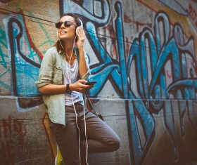 Wearing headphones listening to music young girl Stock Photo 04