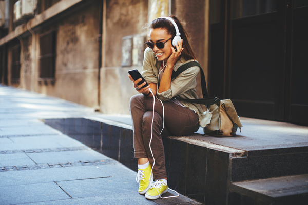 Wearing headphones listening to music young girl Stock Photo 08