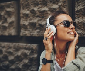 Wearing headphones listening to music young girl Stock Photo 09