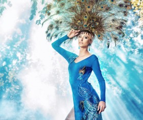 Woman with peacock feathers Stock Photo
