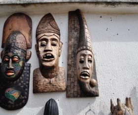 Wooden masks hanging from the wall Stock Photo