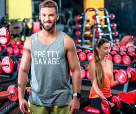Workout in the gym for men and women Stock Photo 01