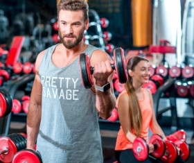 Workout in the gym for men and women Stock Photo 02