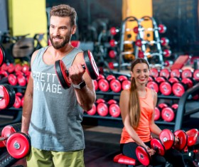 Workout in the gym for men and women Stock Photo 03