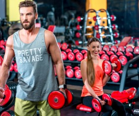 Workout in the gym for men and women Stock Photo 04