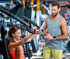 Workout in the gym for men and women Stock Photo 06