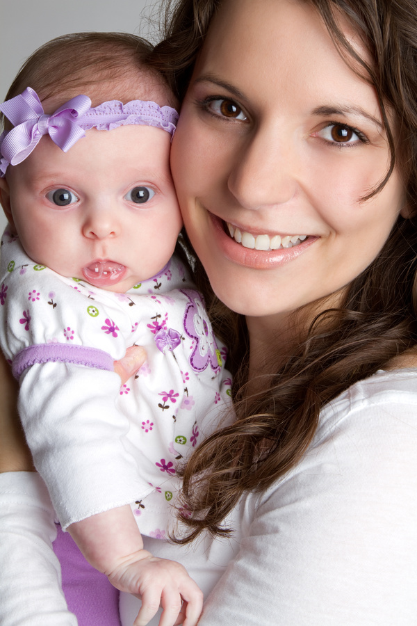 Young mother holding newborn child Stock Photo