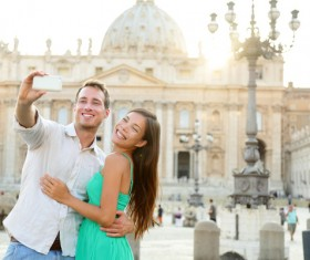 couple who took pictures before the Romanesque building Stock Photo