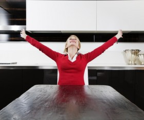 woman stretching her arms at the table Stock Photo
