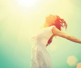 woman stretching her arms in the sun Stock Photo
