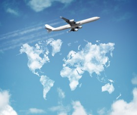 A passenger plane flying under the blue sky Stock Photo