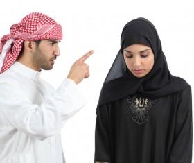 Arab man accused his wife Stock Photo